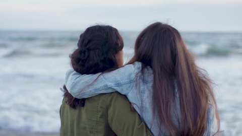 19a25d6d93 Portrait Of Girlfriends With Their Arms Around Each Other, Enjoying Ocean  Views (Shot On