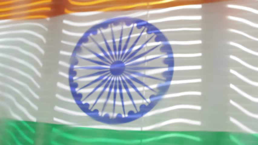 Indian flag is moving from the blowing draft at jalousie window in sunny day. | Shutterstock HD Video #1011412244