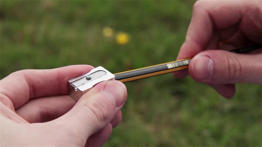 Sharpening a Pencil with a Sharpener in the Park.