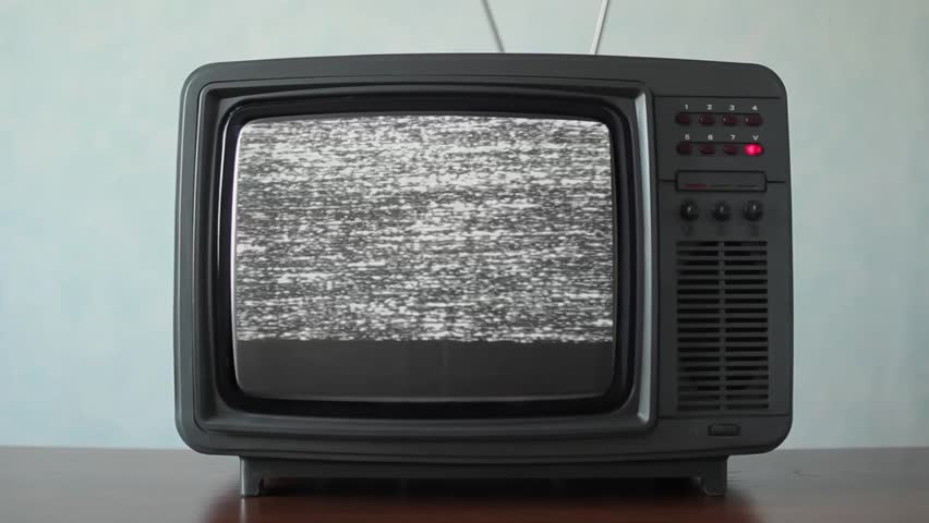 Static noise on a vintage TV set in a room | Shutterstock HD Video #1011465284