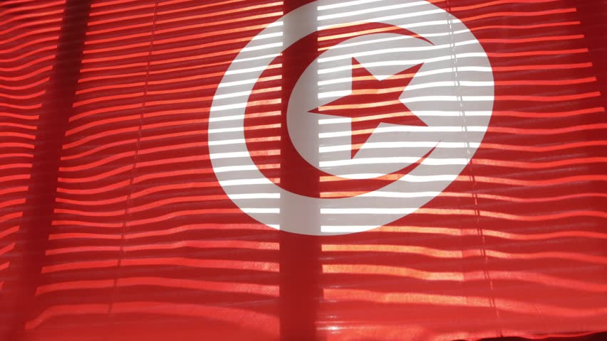 Tunisian flag hanging at wide jalousie window. Closeup  | Shutterstock HD Video #1011468854