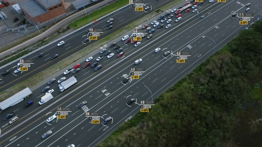 Highway aerial view with fake car speed, plate number, driver information and ID. Perfect to illustrate concepts as: surveillance, big data, traffic control, futuristic cities. Future transportation.  #1011485624
