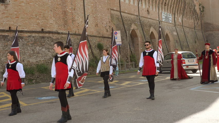 LUGO (RA), ITALY - MAY 20, 2018: people in costume in medieval parade under castle