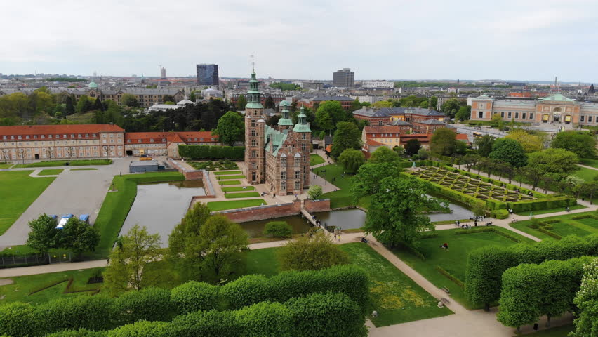 Aerial view of Rosenborg Castle (renaissance style palace) situated in The King's Garden (Kongens Have) - central Copenhagen, capital city of Denmark from above | Shutterstock HD Video #1011516224