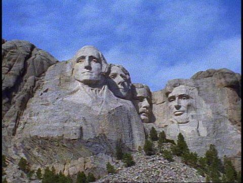 MT. RUSHMORE, 1999, Mount Rushmore, medium shot zoom in close up front view