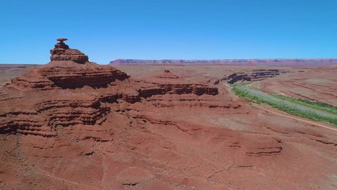 Mexican Hat rock formation aerial with San Juan River in American Southwest desert