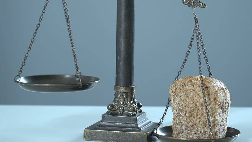 Bread and dollars on scales, concept of living wage, gross domestic product