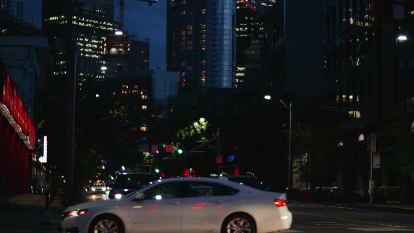 Urban Streets Night Background Cars Passing Buildings