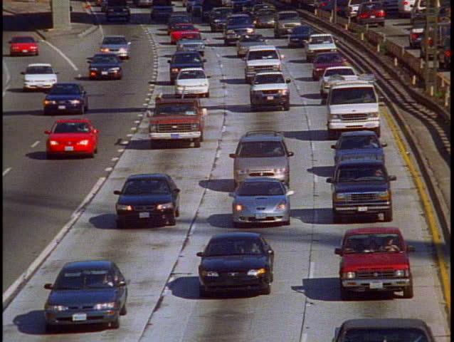LOS ANGELES, 1999, Freeway traffic Los Angeles | Shutterstock HD Video #1011654734