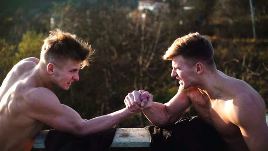 Arms wrestling, competition. Rivalry concept - close up of male arm wrestling. Leadership concept. Rivalry, vs, challenge, strength comparison. Two men arm wrestling.