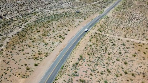 Car driving through desert highway outside Valley of Fire Nevada USA