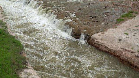 Norden Chute on Niobrara River in Nebraska,  springtime scenery with flying cliff swallows