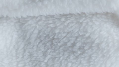 White fleece material in extreme close up stock footage