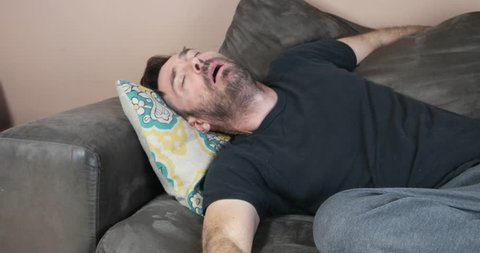 sleeping guy falling from couch