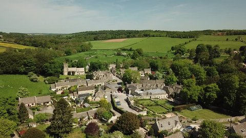 Aerial of English small village on the Cotswold Hills in England