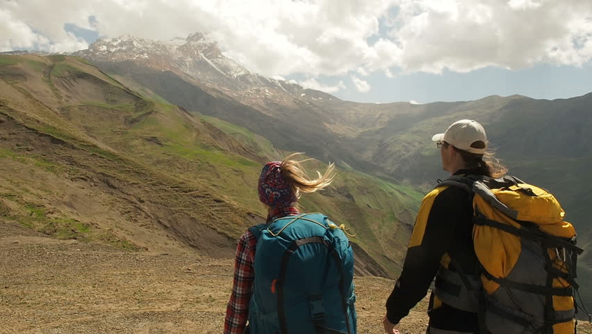 Couple Tourists on top of mountain looking at mountains. Hiker couple travel enjoy life scenic nature landscape. Summer vacation travel adventure.  Backpackers trekking mountains summer hike.  #1011759104