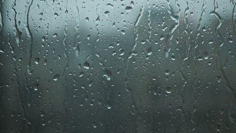 Heavy rain on window - bad weather