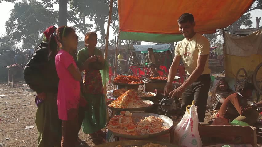 Bardia, Nepal - January 16, 2014: Preparing local food in fairground in during Maggy festival in Bardia, Nepal #1011798584