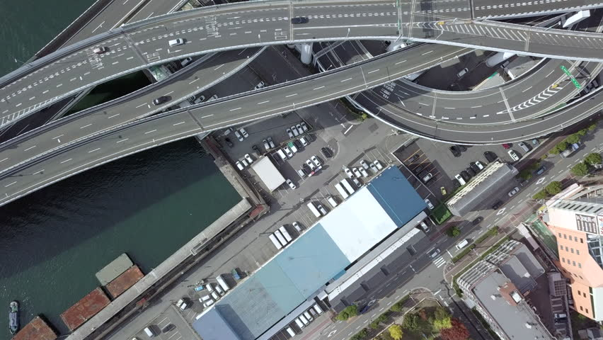 Top view over the highway, expressway and motorway, Aerial view interchange of Osaka City, Osaka, Kansai, Japan. | Shutterstock HD Video #1011819104