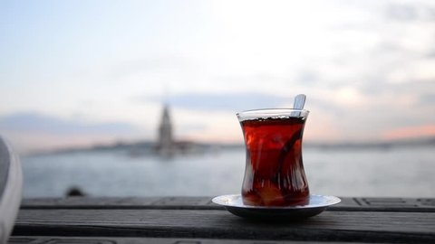 Turkish tea at sunset in front of maiden tower at Istanbul
