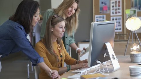 Start-up young women in office, co-working area