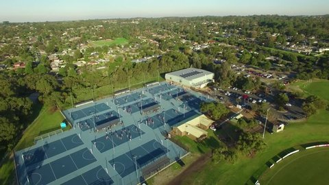Static aerial shot of people playing on sports courts