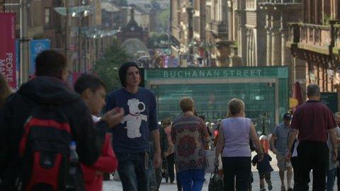 Glasgow, United Kingdom - May, 2016: People walking on the busy Buchanan Street
