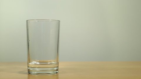 Glass of water being filled