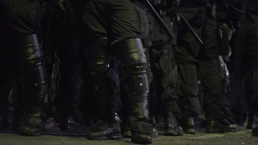 Riot police officer protective boots kneepads gear, violent protest, Germany