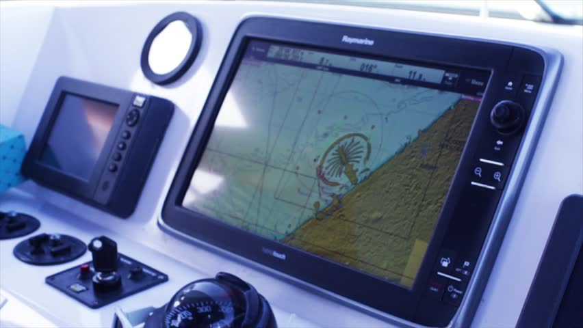 View of an echo sounder on board a marine vessel. Stock. Echo sounding is a type of sonar used to determine the depth of water by transmitting sound pulses into water