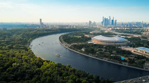 RUSSIA MOSCOW JUNE 2018: Flying around the stadium Luzhniki and Moskva river. Moscow-city towers on the horizon. Beautiful day with bright blue and a little hazy sky.