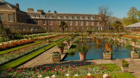 LONDON, circa 2018 - Slow pan and tilt shot of the beautiful Sunken Garden and the Kensington Palace in London, England, UK. The palace is home to Prince Harry and Meghan Markle