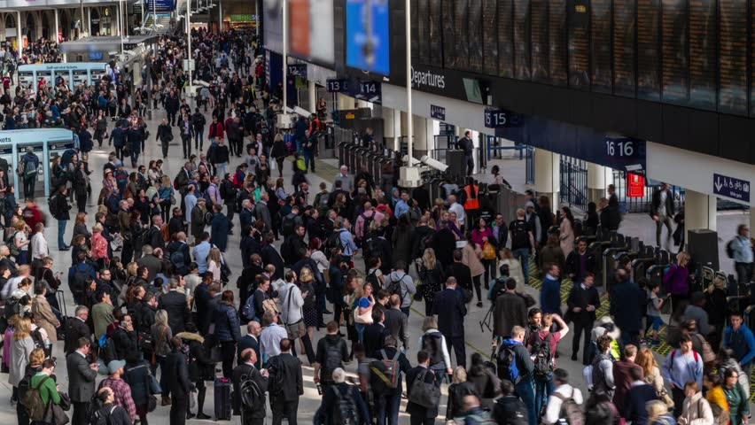 Timelapse view of the interior of Waterloo station in London at rush time with commuters and shoppers | Shutterstock HD Video #1012034114