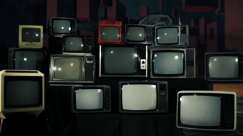 Many Tvs with Green Screens Turning On. Iron Tone. Zoom In. Aesthetics of the 80s. Ready to Replace Green Screens with Any Footage or Picture you Want.  | Shutterstock HD Video #1012062134