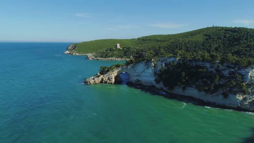 White rocks and blue sea east coast of Italy Apulia Bari, Vieste, Adriatic Sea, Cave of the Bell, Torre di San Felice, Architiello of San Felice, mountains