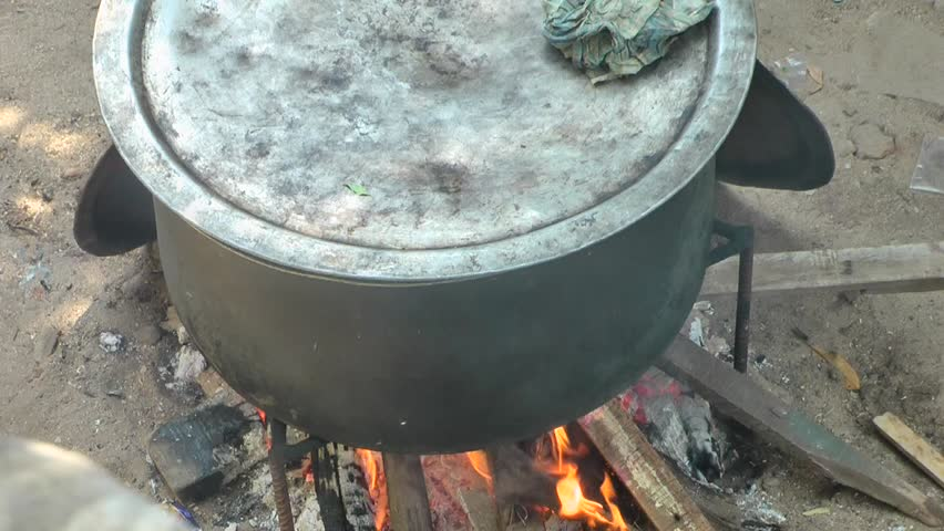 Food and Drink Time Lapse Video Footage: Tastily Indian Mutton Biryani Cooking On Wooden Stove #1012119074