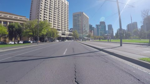 Adelaide, South Australia - April 29, 2018: Action camera vehicle POV driving along Victoria Square past the law courts and Hilton Adelaide hotel.
