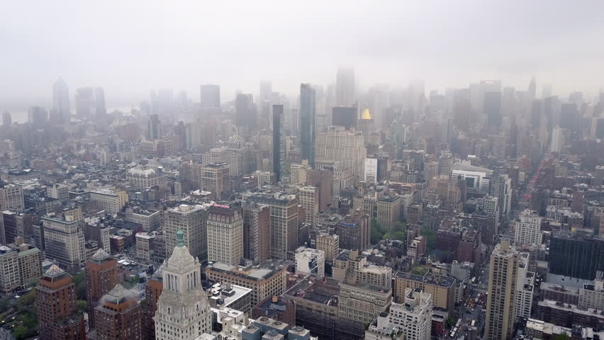 Aerial view of New York, Midtown Manhattan. Residental buildings, streets ans crossroads from above. USA. Drone shot | Shutterstock HD Video #1012155134