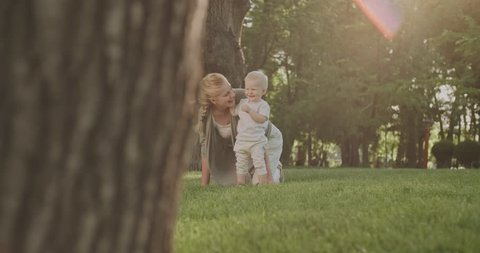 happy emotional family moments, mom with baby slow motion, Sunny summer day in the Park