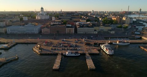 Helsinki market square, C4K aerial sideway view of the Helsinki cathedral and the city, on a sunny summer evening dusk, in Helsingfors, Uusimaa, Finland