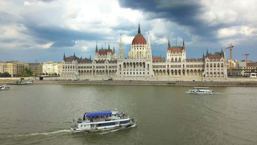 Budapest, Hungary - Sightseeing boat on River Danube next to Hungarian Parliament at daytime | Shutterstock HD Video #1012209434