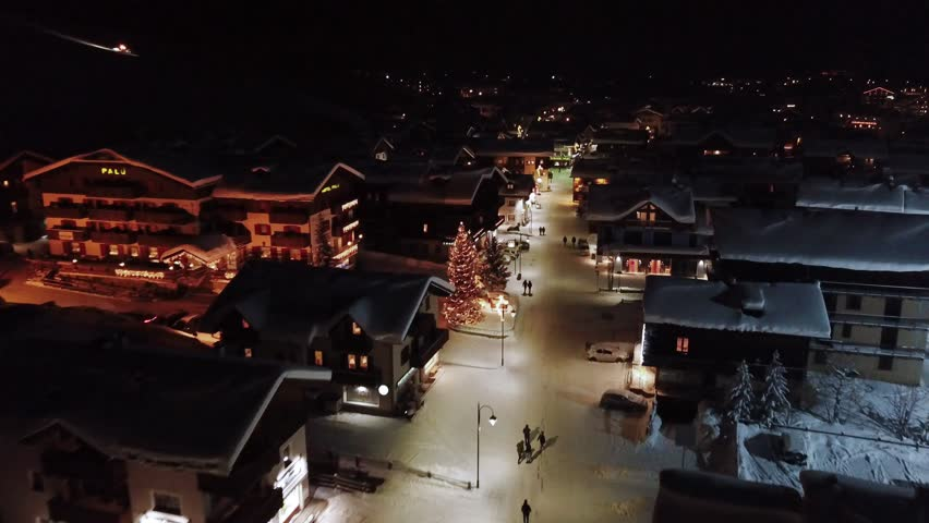 Aerial (drone) footage of a ski town at night