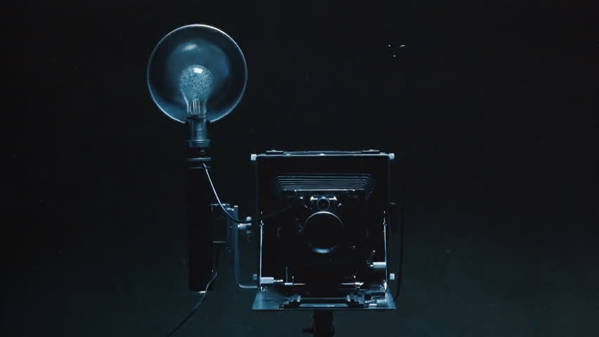 Photo studio.Old camera with flashbulb.Montage. | Shutterstock HD Video #1012277774