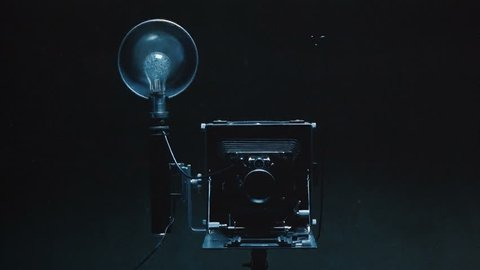 Photo studio.Old camera with flashbulb.Montage.