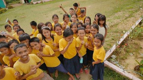 Bohol, Philippines - October 13, 2015: Joyful Filipino schoolchildren of primary classes on the island of Bohol.