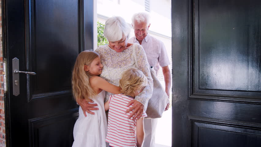 Grandchildren run to greet grandparents as they arrive