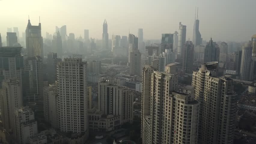 Helicopter Shanghai China Modern cityscape Unique Skyscrapers glass concrete Urban Financial business Technology futuristic city life Roof spire horizon. Fog smoke ecology pollution. Aerial Drift 4k