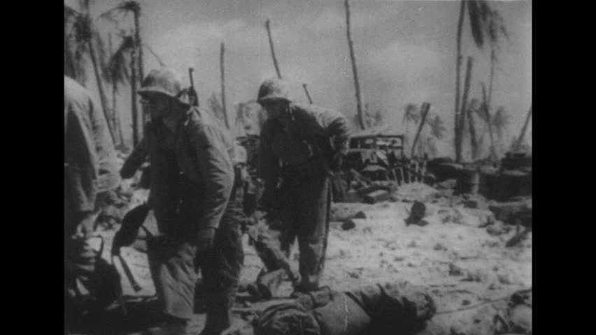 Circa 1960s united states army 101st airborne division soldiers japan 1940s soldiers carry wounded man on stretcher dead bodies on beach soldier sciox Choice Image