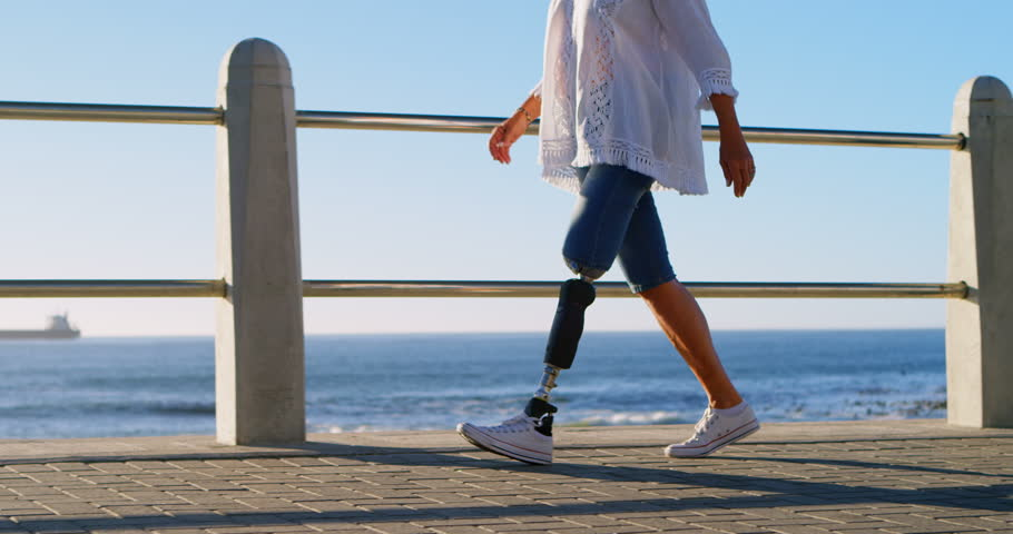 Midsection of disabled woman walking near beach on a sunny day 4k | Shutterstock HD Video #1012345994