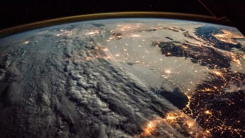 Time lapse of the planet earth from SIS. City lights at night.  France, Spain, Italy and mediterranean islands. Elements of this image courtesy of NASA